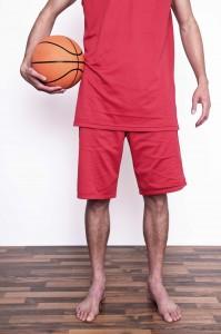 He's tall because he plays basketball.